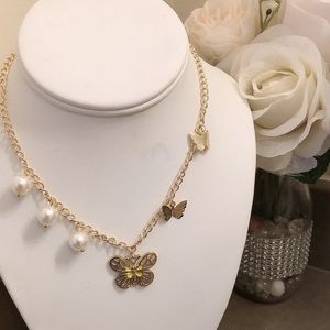 Butterfly designed perl necklace